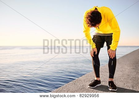 Workout Outdoor Runner. Man Running Taking A Break From Run Outside In Beautiful Seaside. Fit Young