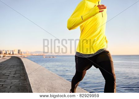 Jogging Athlete Man Running At Sun Sunset Beach In Barcelona City Background. Fitness Runner Jew