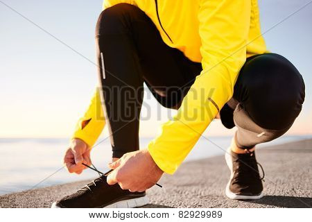 Running Shoes. Barefoot Running Shoes Closeup. Man Tying Laces Before Jogging In Minimalistic