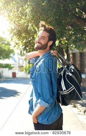 Happy Man Walking Away With Travel Bag