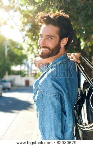 Smiling Man Walking Away With Bag
