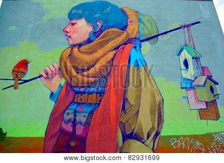Street art Montreal woman an bird