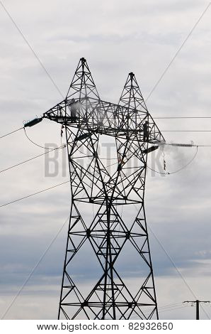 Two Guys Cleaning Big Electrical Pylon