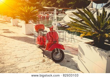 Photo Of Vintage Red Scooter Parked On Street At Sunny Day