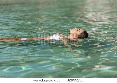 Woman On Holidays Relaxing And Bathing In A Tropical Beach