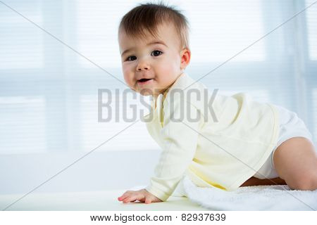Happy crawling baby. Side view