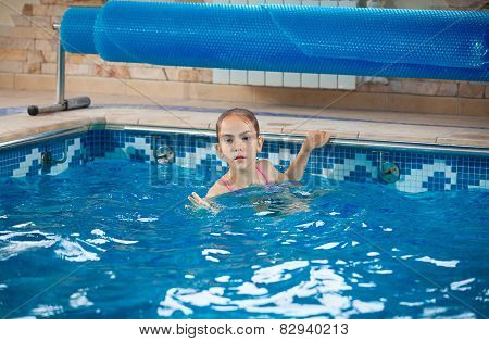 Young Girl Learning How To Swim In Pool