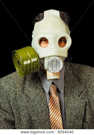 Portrait Of Person In A Gas Mask On Black Background