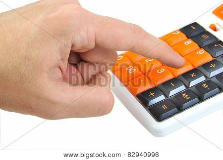 Caucasian hand making calculations on an orange calculator isolated on white background