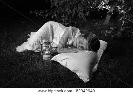 Monochrome Photo Of Woman Sleeping At Garden At Night