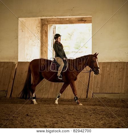 Woman Jockey Doing Training At Indoor Arena