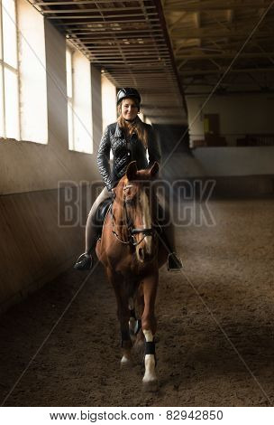 Photo Of Young Woman Jockey Riding Horse On Manege