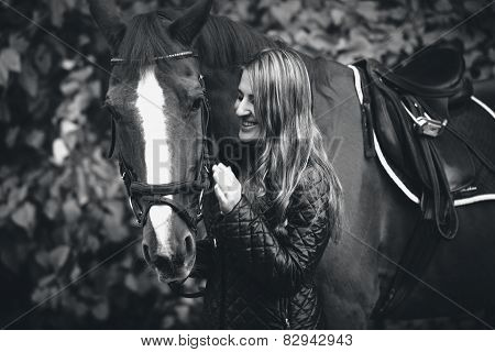 Black And White Portrait Of Smiling Woman Walking With Horse