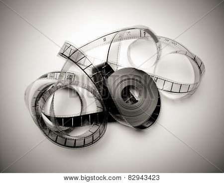 Unrolled 35Mm Movie Reel In Vintage Black And White