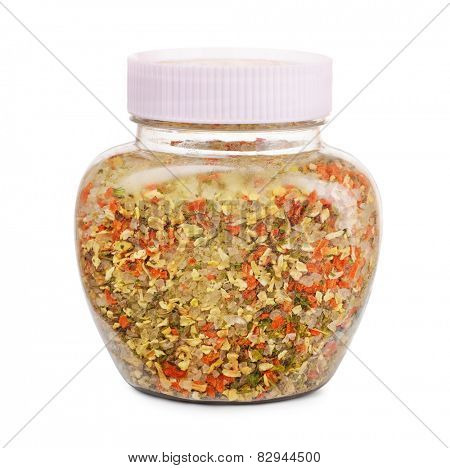 Jar of herbs, spicees and salt seasoning blend isolated on white
