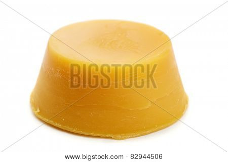 Natural beeswax isolated on white