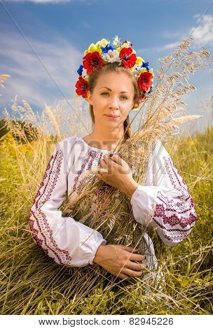Ukrainian Woman In Embroidered Shirt Holding Sheaf Of Wheat
