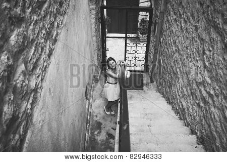 Monochrome Photo Of Young Woman Standing At Entrance Old Building