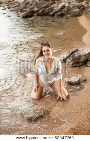 Sexy Woman In Shirt Kneeling On Sandy Beach