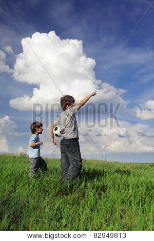 boy showing something to his friend in the clouds incredible miracle
