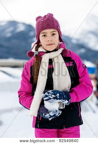 Cute Girl Playing In Snowballs On Top Of High Mountain