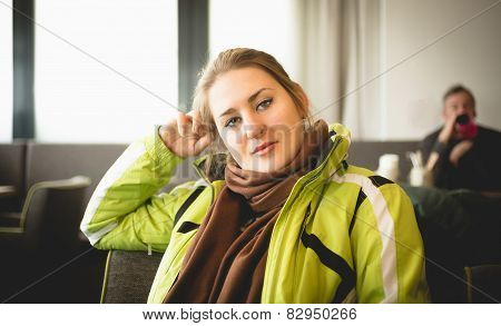 Woman In Ski Jacket Relaxing At Restaurant On Mountain Top
