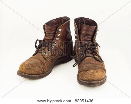 Old leather boots on white background
