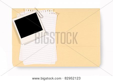 Office Folder With Untidy Note Paper And Blank Polaroid