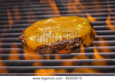 Cheeseburgers on a Hot Flaming Grill
