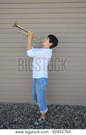 Female trumpet player.