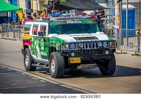 Police cars patrolling streets just before Colombia's most important folklore celebration, the Carni