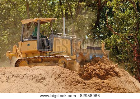 Pushing dirt and rock with a bulldozer