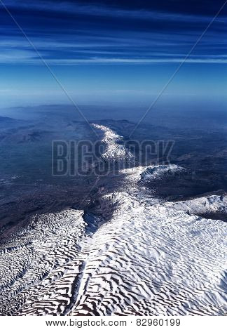 Beautiful aerial view on mountain range, amazing panoramic landscape of high snowy mountains, beauty of winter nature