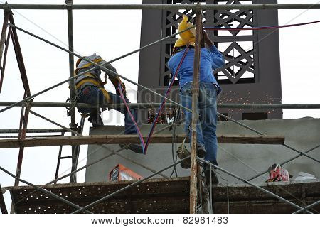 Welders working at high level