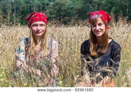 Two teenage girls sitting in corn field