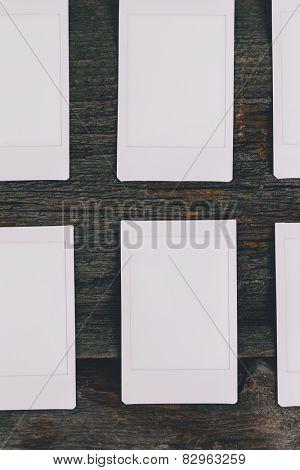 Polaroid on the wooden table