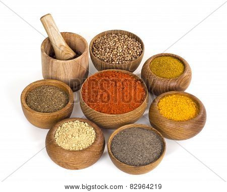 Spices And Seasoning In Wooden Bowl On White Background