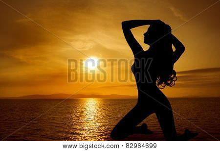 Woman Sexy Silhouette Over Sky Sunset On Sea