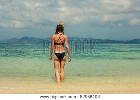 Woman With Snorkel On The Beach
