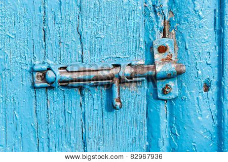 Espagnolette On Old Blue Painted Door