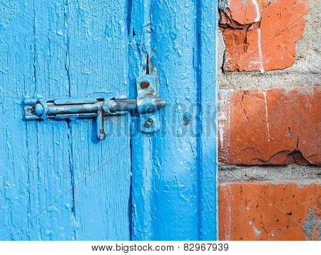 Espagnolette On Old Blue Painted Door Of Shed
