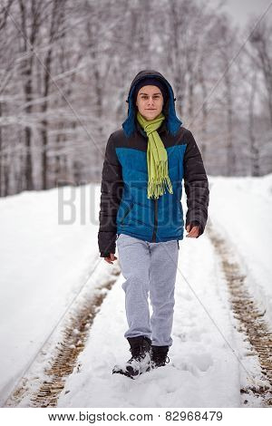 Teenager Walking Trough The Forest On Wintertime