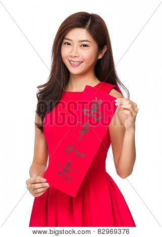 Woman with Fai Chun for Chinese new year, phrase meaning is everything goes smooth