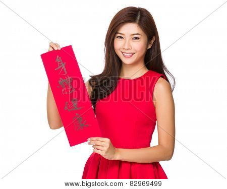 Woman with Fai Chun for Chinese new year, phrase meaning is blessing for good health
