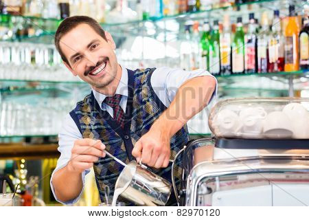 Barista in cafe or coffee bar preparing pouring espresso shot in glass of latte macchiato