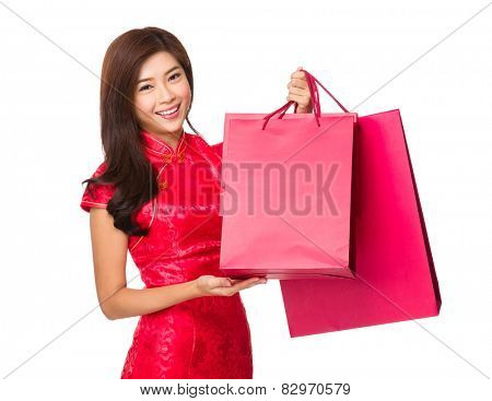Chinese woman with cheongsam and hold shopping bag