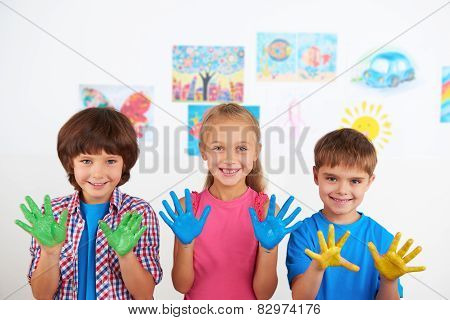 Happy children showing painted hands