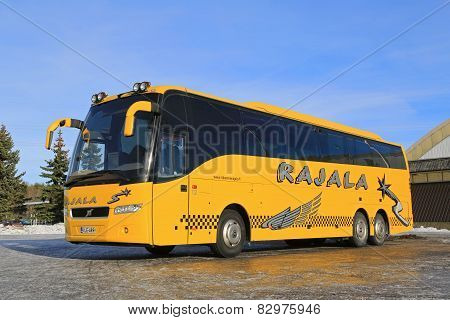 Yellow Volvo Coach Bus Parked In Winter