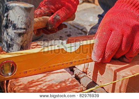 Bricklayer With Brick
