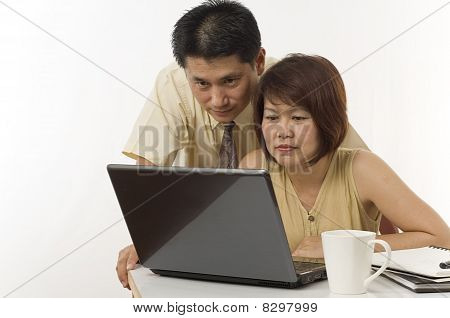 Asian Couple With Computer